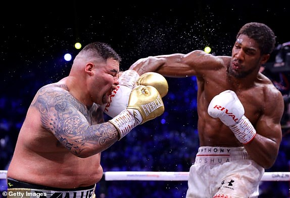 Anthony Joshua reclaims his heavyweight belts